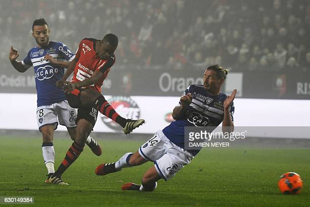 Rennes' Cape Verdean midfielder Gelson Fernandes kicks the ball despite Bastia's French midfielder Allan Saint Maximin and Bastia's Algerian...
