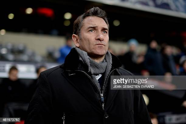 Rennes coach Philippe Montanier watches play on January 22 2015 during a French Cup football match Rennes vs Reims at the Route de Lorient stadium in...
