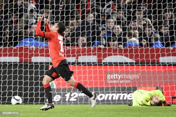 TOPSHOT Rennes' Colombian midfielder Juan Fernando Quintero celebrates after scoring a goal against Caen's French goalkeeper Remy Vercoutre during...
