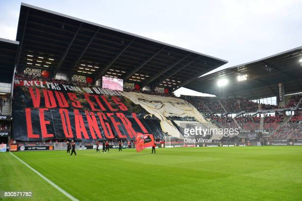 Rennes fans unfold a banner before the Ligue 1 match between Stade Rennais and Olympique Lyonnais at Roazhon Park on August 11 2017 in Rennes