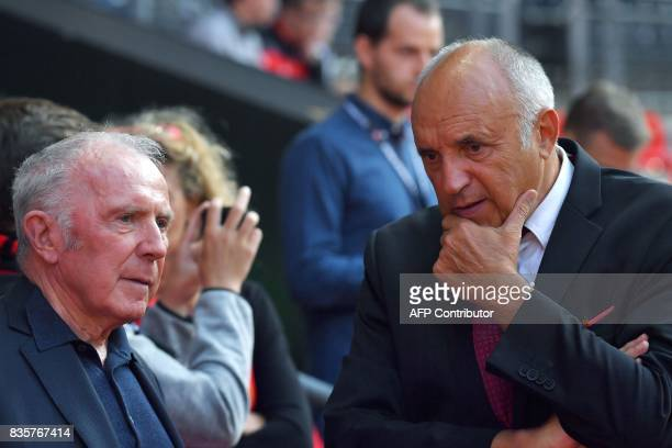 Rennes football club owner and business man Francois Pinault talks to Rennes' French club president Rene Ruello prior to the beginning of the French...