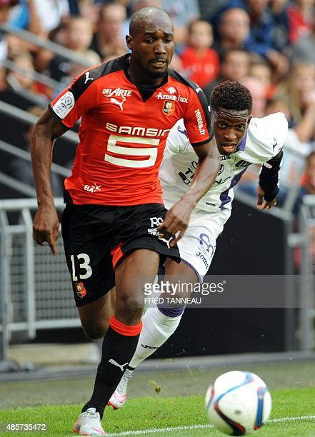 Rennes' forward Giovanni Sio vies with Toulouse's defender Francois Moubandje during the French L1 football match Rennes against Toulouse on August...
