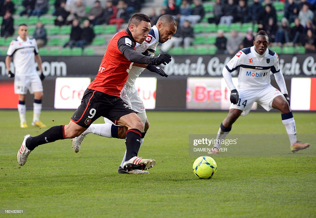 Rennes forward Mevlut Erding (L) fights for the ball with Sochaux' Malian defender Cedric Kante on February 23, 2013 during a French L1 football match at the Route de Lorient stadium in the western French city of Rennes. MEYER