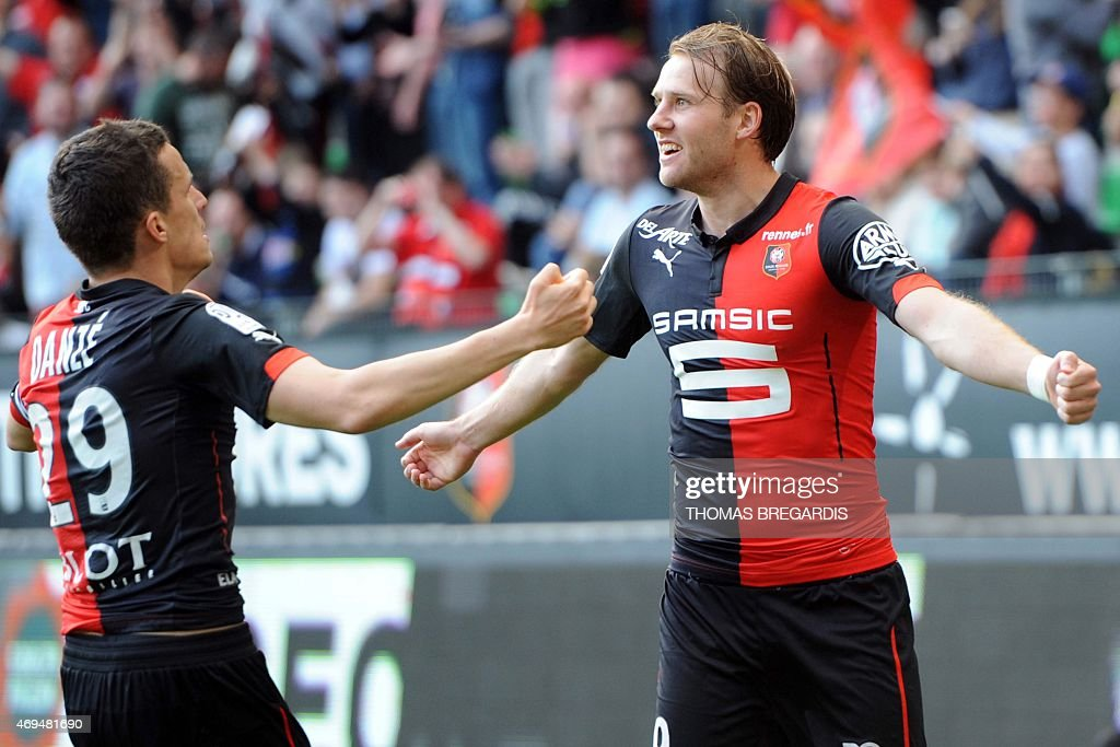 Rennes' forward <a gi-track='captionPersonalityLinkClicked' href=/galleries/search?phrase=Ola+Toivonen&family=editorial&specificpeople=4495763 ng-click='$event.stopPropagation()'>Ola Toivonen</a> (R) celebrates with Rennes's French defender <a gi-track='captionPersonalityLinkClicked' href=/galleries/search?phrase=Romain+Danze&family=editorial&specificpeople=4121826 ng-click='$event.stopPropagation()'>Romain Danze</a> after scoring during the French L1 football match between Rennes and Guingamp on April 12, 2015 at the route de Lorient stadium in Rennes, western France.
