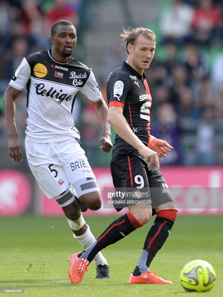 Rennes' forward Ola Toivonen (R) vies with Guingamp' midfileder Moustapha Diallo during the French L1 football match between Rennes and Guingamp on April 12, 2015 at the route de Lorient stadium in Rennes, western France.