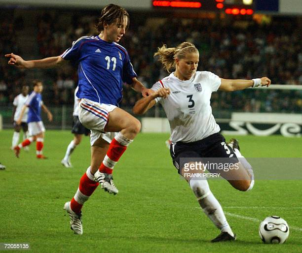 French forward Laetitia Tonazzi vies with England's defender Rachel Unitt during their Feminine international football match France versus England 30...