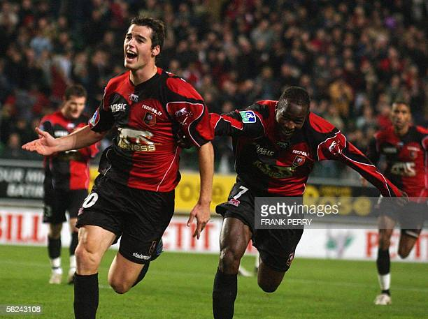 Rennes' midfielder Yoann Gourcuff jubilates with his teammate John Utaka after scoring against Toulouse during their French 1rst League match 20...