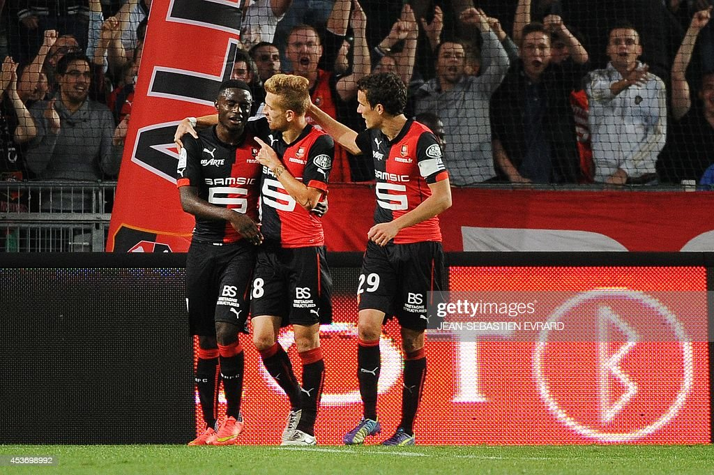 Rennes' French Cameroonian forward PaulGeorges Ntep celebrates with his teammates after scoring a goal during the French L1 football match between...