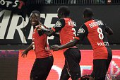 Rennes' French Cameroonian forward PaulGeorges Ntep celebrates with teammates after scoring a goal during the French L1 football match between Rennes...