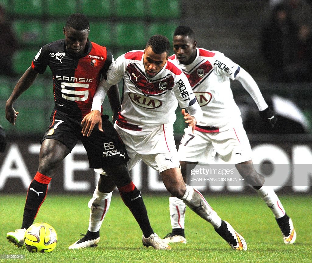 Rennes' French Cameroonian forward Paul-Georges Ntep (L) vies for the ball with Bordeaux's Dannish forward Isaac Kiese Thekin (C) and Bordeaux's French defender <a gi-track='captionPersonalityLinkClicked' href=/galleries/search?phrase=Marc+Planus&family=editorial&specificpeople=708262 ng-click='$event.stopPropagation()'>Marc Planus</a> (R) during the French L1 football match between Rennes (Stade Rennais FC) and Bordeaux (FCGB) on February 21, 2015, at route de Lorient stadium in Rennes, western France.