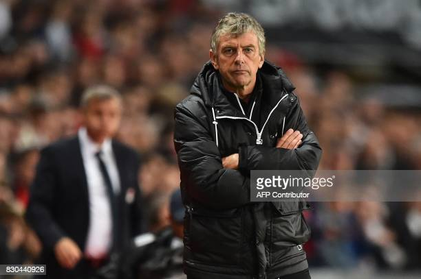 Rennes' French coach Christian Gourcuff reacts during the French L1 football match between Stade Rennais and Olympique Lyonnais on August 11 at the...
