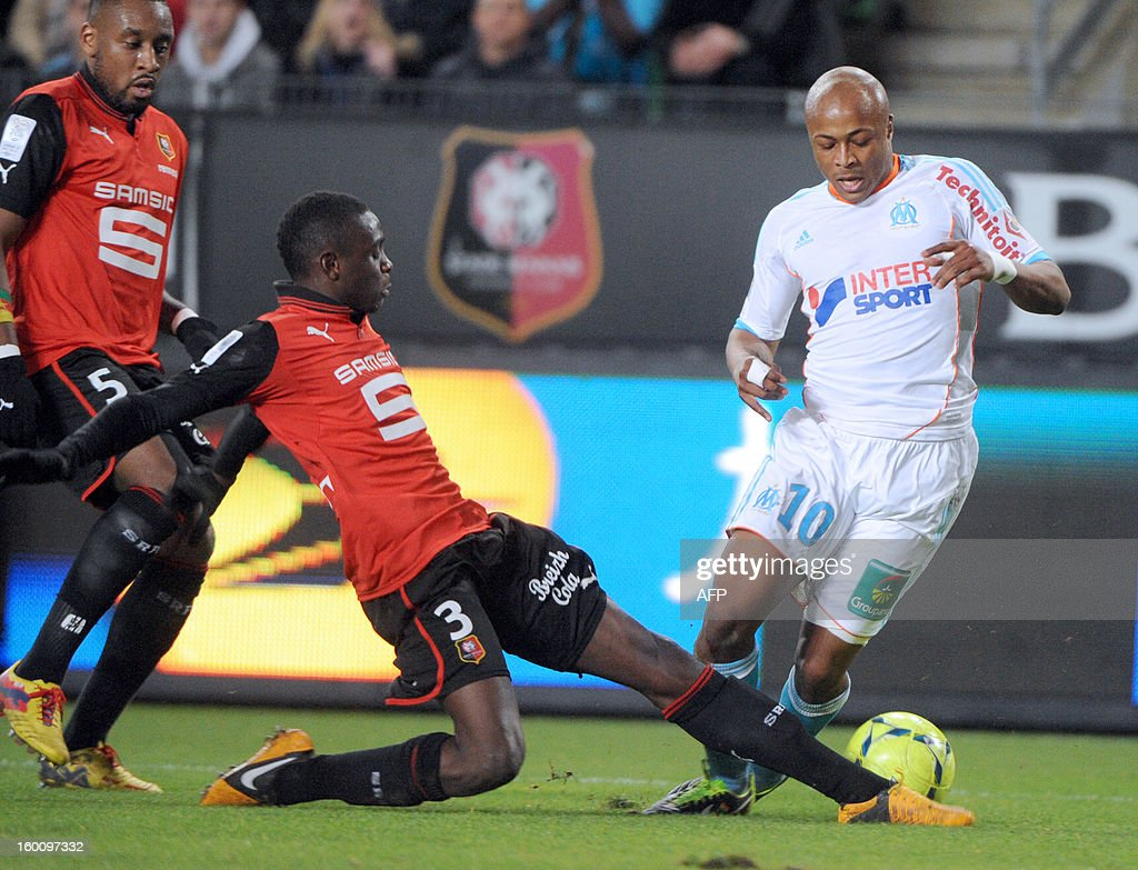 Rennes' French Congolese defender Chris Mavinga (L) vies with Marseille's Ghanaian midfielder Andre Ayew during the French L1 football match Stade Rennais FC vs Marseille, on January 26, 2013 at the route de Lorient stadium in Rennes, western France.