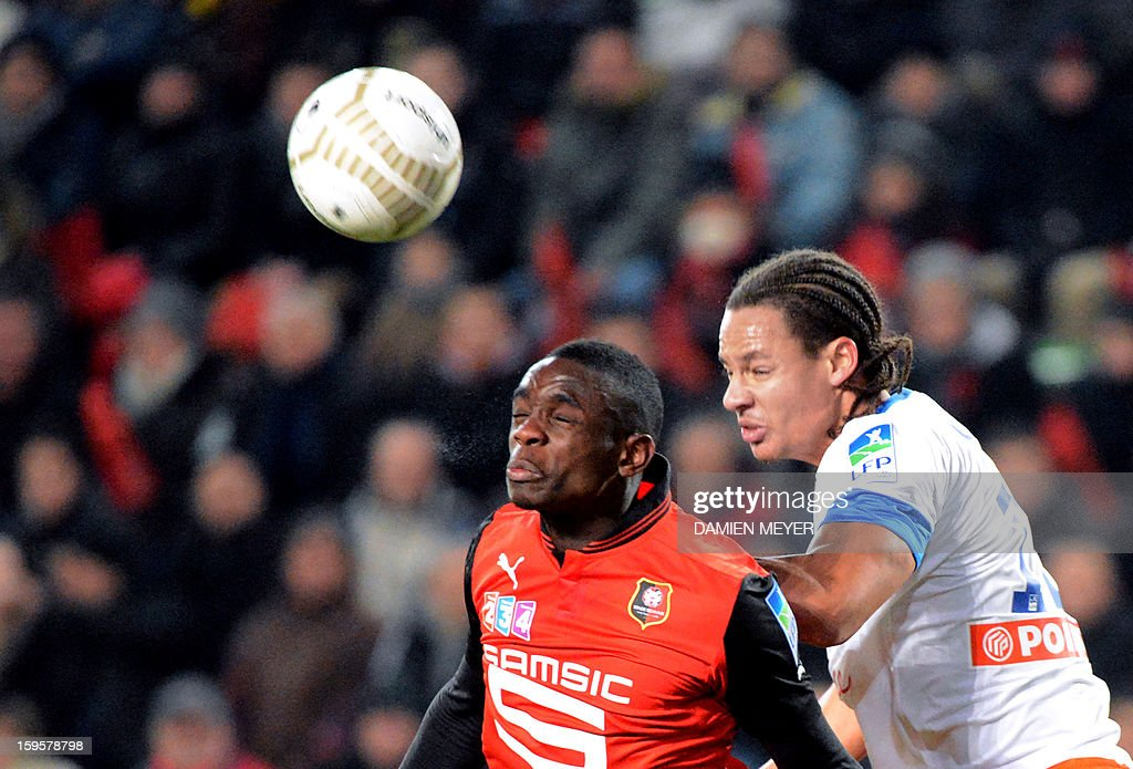 Rennes' French defender Chris Mavinga (L) heads the ball despite Montpellier's French defender Daniel Congre during the French League Cup semifinal football match Rennes against Montpellier on January 16, 2013 at the route de Lorient stadium in Rennes, western France.