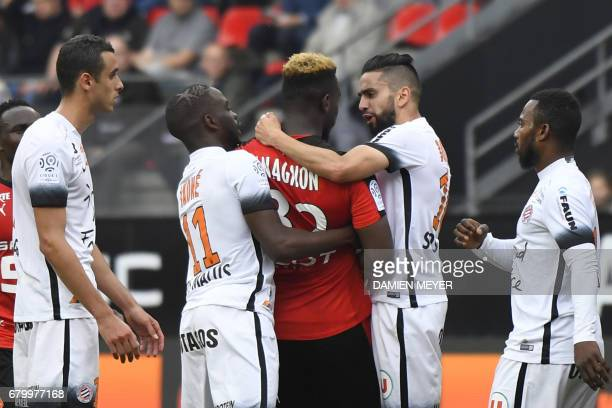 Rennes' French defender Joris Gnagnon argues with Montpellier's midfielder Jonathan Ikone and Montpellier's Algerian midfielder Ryad Boudebouz during...