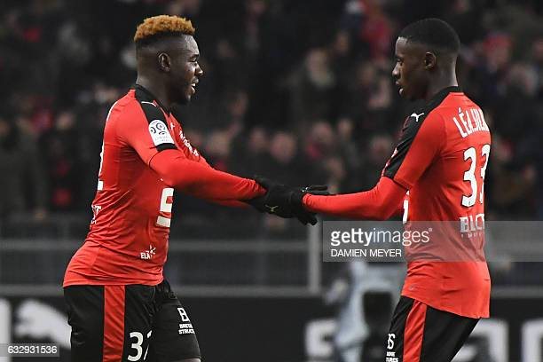 Rennes' French defender Joris Gnagnon celebrates with Rennes' French striker James Lea Siliki after scoring a goal during the French L1 football...