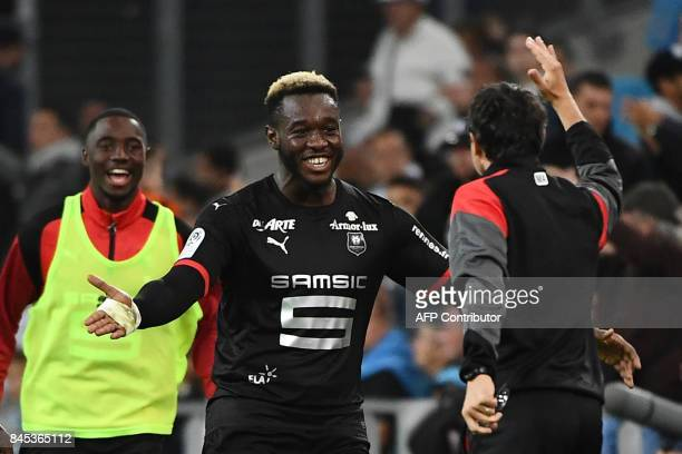 Rennes' French defender Joris Gnagnon celebrates with teammates after scoring the third goal during the French L1 football match Olympique of...