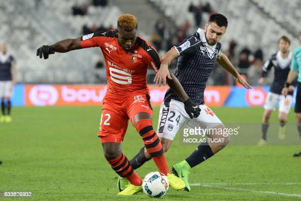 Rennes' French defender Joris Gnagnon vies with Bordeaux's French forward Gaetan Laborde during the French Ligue 1 football match between Bordeaux...