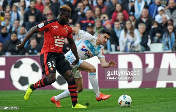 Rennes' French defender Joris Gnagnon vies with Olympique de Marseille's French midfielder Morgan Sanson during the French L1 football match...