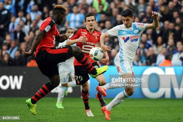 Rennes' French defender Joris Gnagnon vies with Olympique de Marseille's French midfielder Morgan Sanson during the French L1 football match between...