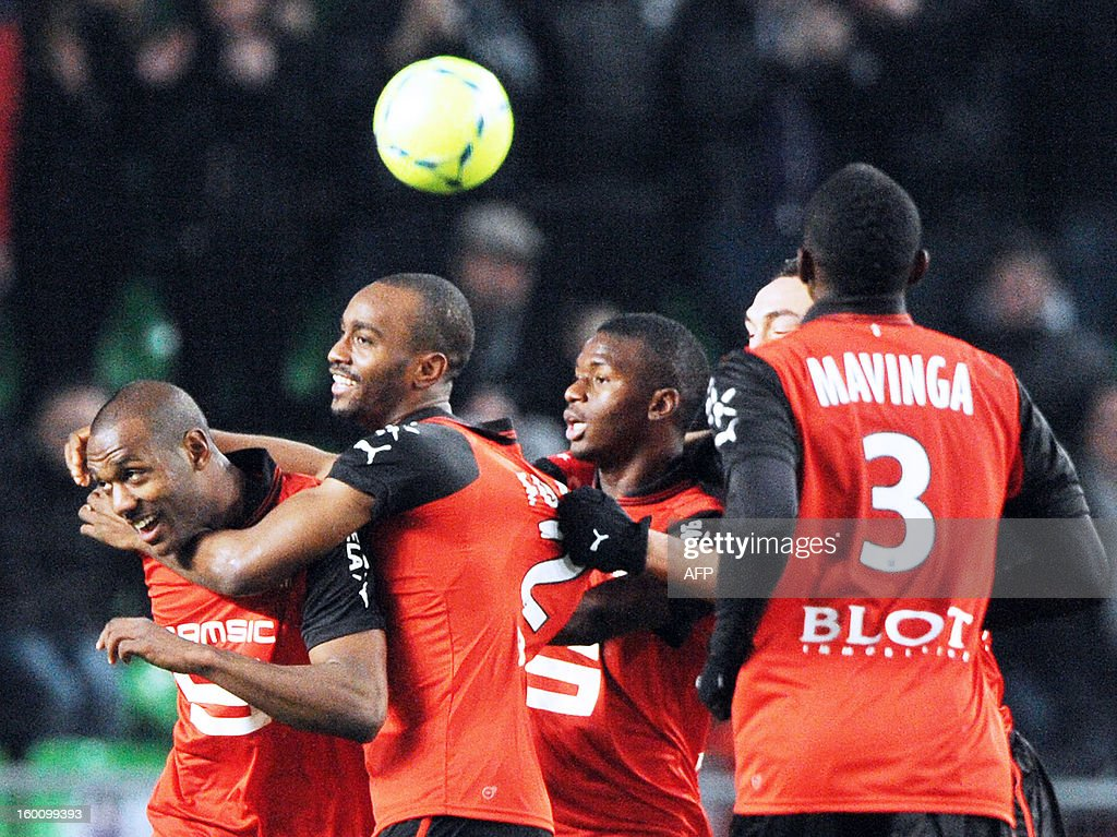 Rennes' French defender Kevin Theophile Catherine (L) is congratulated by teammates French defender Dimitri Foulquier, French Congolese defender Chris Mavinga (2ndR) after scoring a goal Marseille, during the French L1 football match Stade Rennais FC vs. Marseille, on Januaray 26, 2013 at the route de Lorient stadium in Rennes, western France.