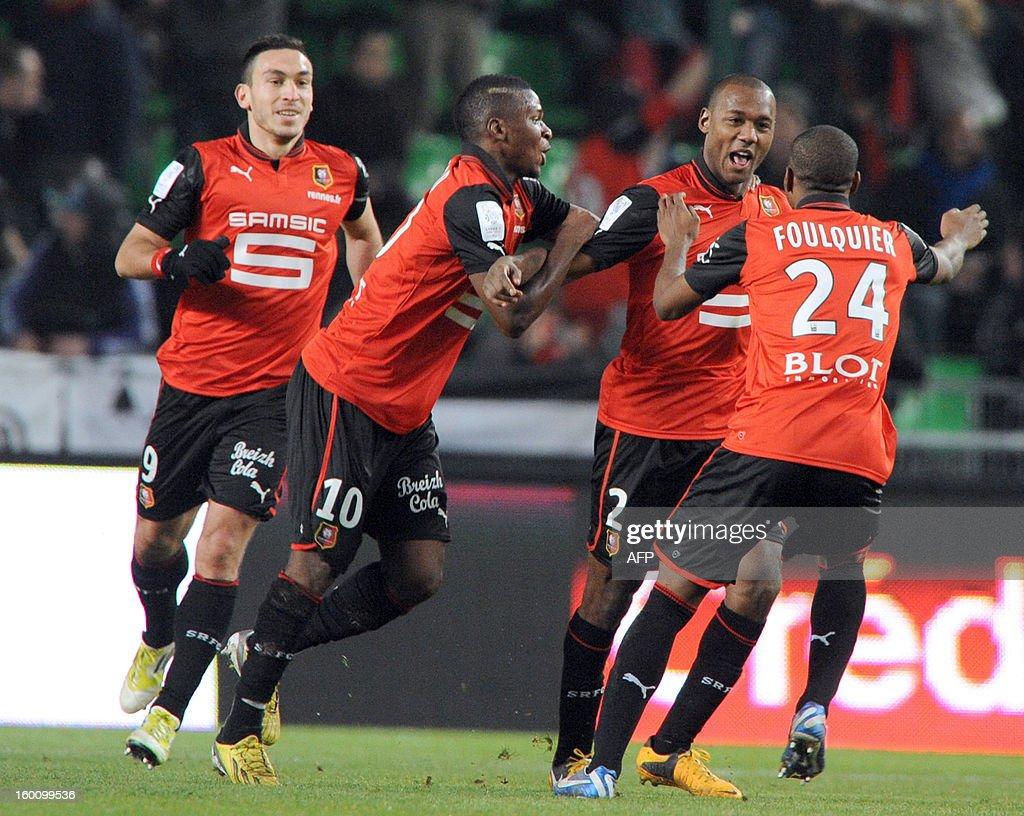 Rennes' French defender Kevin Theophile Catherine (3rdL) is congratulated by teammates Turkish forward Mevlut Erding (L), Guinean midfielder Sadio Diallo Rennes' French defender Dimitri Foulquier after scoring a goal during the French L1 football match Stade Rennais FC vs. Marseille, on Januaray 26, 2013 at the route de Lorient stadium in Rennes, western France.
