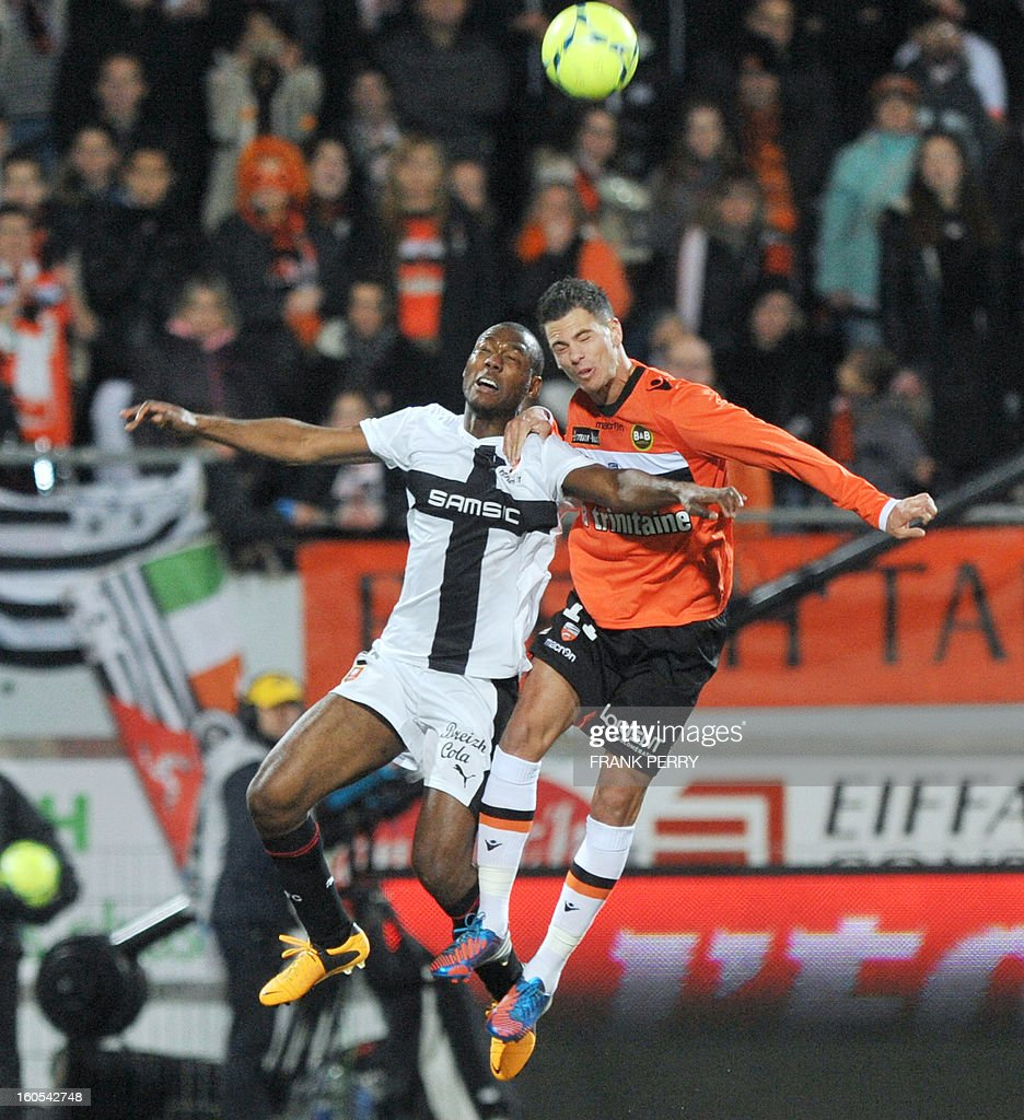 Rennes' French defender Kevin Theophile Catherine (L) vies with Lorient's French forward Jeremie Aliadiere (R) during the French L1 football match Lorient (FCLBS) vs Rennes (SRFC) , on February 2, 2013 at the Moustoir Stadium in Lorient, western France.