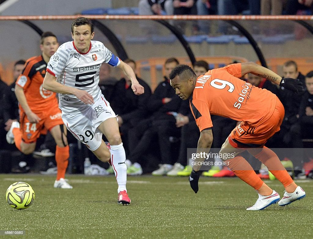 Rennes' French defender <a gi-track='captionPersonalityLinkClicked' href=/galleries/search?phrase=Romain+Danze&family=editorial&specificpeople=4121826 ng-click='$event.stopPropagation()'>Romain Danze</a> (L) and Lorient's Ghanaian forward <a gi-track='captionPersonalityLinkClicked' href=/galleries/search?phrase=Jordan+Ayew&family=editorial&specificpeople=6595555 ng-click='$event.stopPropagation()'>Jordan Ayew</a> (R) fight for the ball during the French L1 football match between FC Lorient and Stade Rennais FC on April 4, 2015 at the Stade du Moustoir in Lorient.