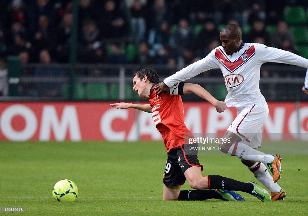 Rennes' French defender Romain Danze (L) fights for the ball with Bordeaux's Cameroonian midfielder Joel Landry Tsafack Ngnemo during a French L1 football match between Rennes and Bordeaux on January 12, 2013 at the route de Lorient stadium in Rennes, western France.