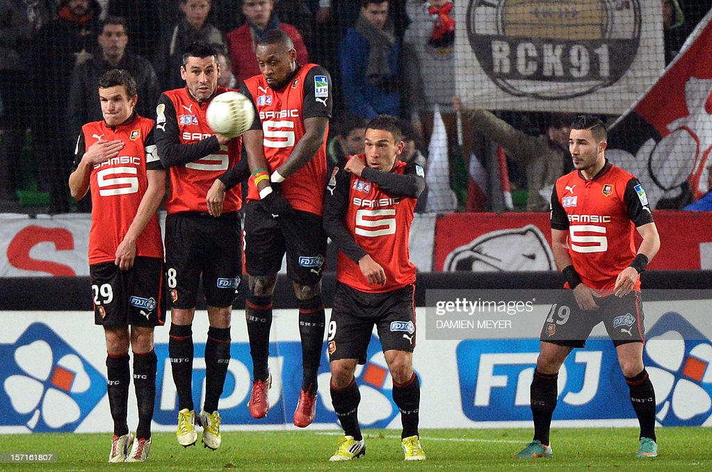 Rennes' French defender Romain Danze, Rennes' French midfielder Julien Feret, Rennes' Senagalese defender Jean Armel Kana Biyik, Rennes' French forward Mevlut Erding and Rennes' French forward Romain Alessandrini stand to block the ball during the French cup football match Rennes against Troyes on November 29 , 2012 at the route de Lorient stadium in Rennes, western France.