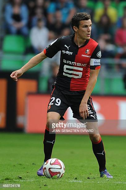 Rennes' French defender Romain Danze runs with the ball during the French L1 football match between Stade Rennais FC and EvianThonon Gaillard FC on...