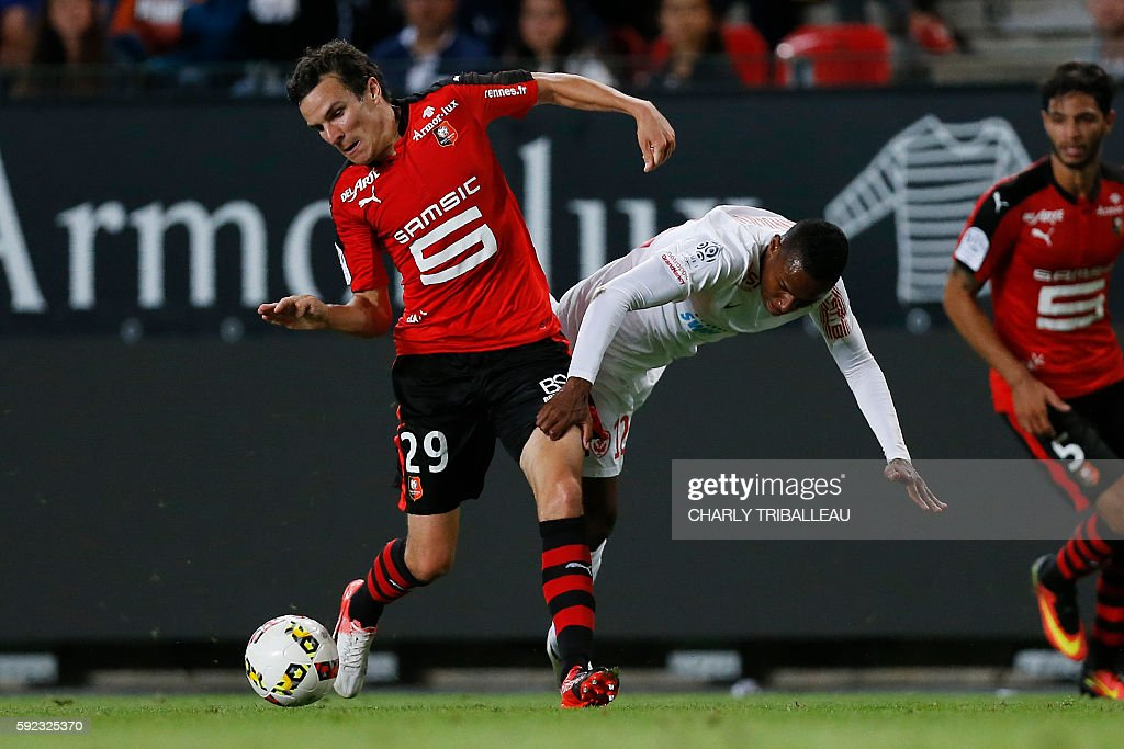 Rennes' French defender Romain Danze vies for the ball with Nancy's French forward Christophe Mandanne during the French L1 football match between...
