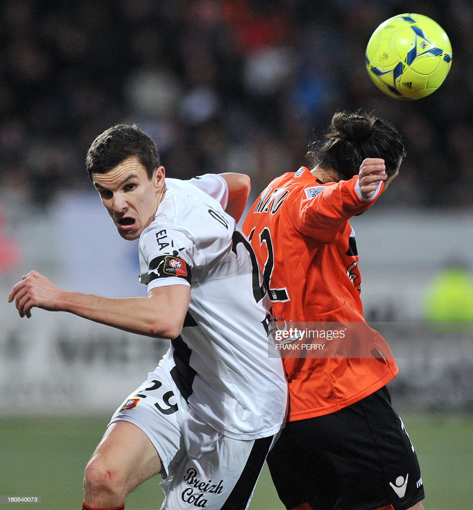 Rennes' French defender Romain Danze (L) vies with Lorient's French forward Lucas Mareque (R) during the French L1 football match Lorient vs Rennes on February 2, 2013 at the Moustoir Stadium in Lorient, western France.