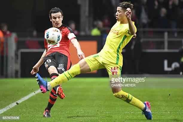 Rennes' French defender Romain Danze vies with Nantes' French midfielder Amine Harit during the French L1 football match Rennes against Nantes on...