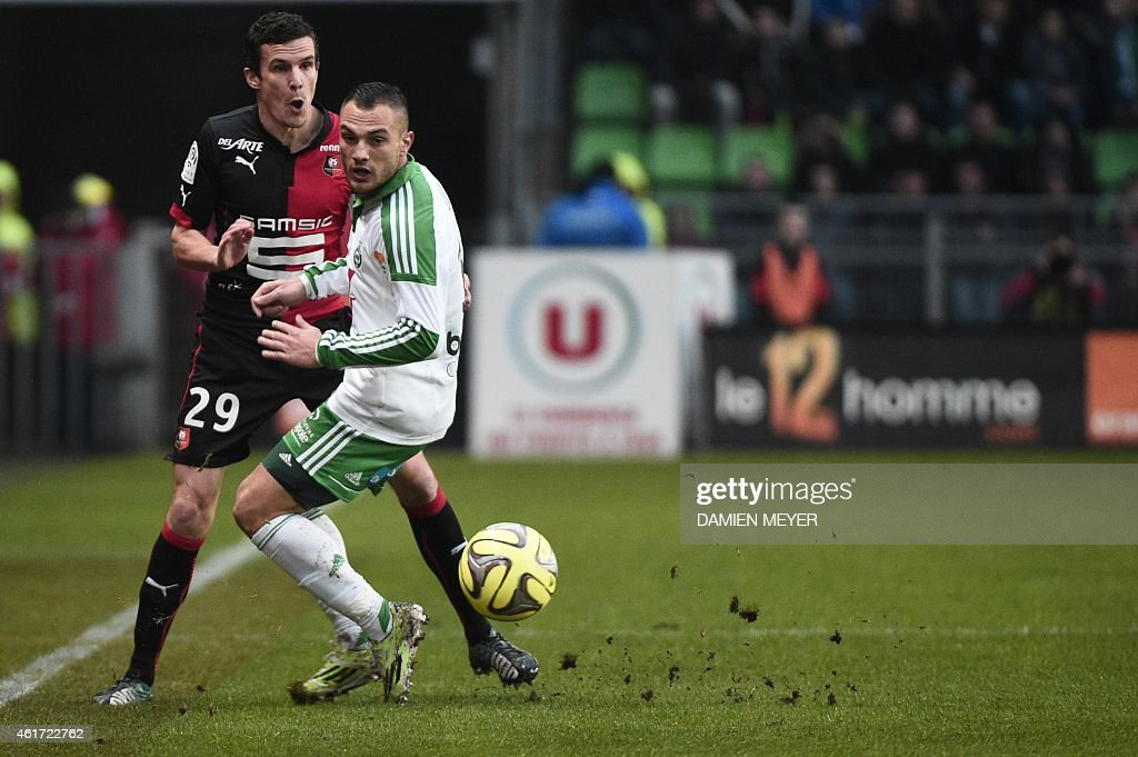 Rennes' French defender <a gi-track='captionPersonalityLinkClicked' href=/galleries/search?phrase=Romain+Danze&family=editorial&specificpeople=4121826 ng-click='$event.stopPropagation()'>Romain Danze</a> (L) vies with Saint-Etienne's French midfielder Yohan Mollo during the French L1 football match Rennes vs Saint-Etienne on January 18, 2015 at the route-de-Lorient stadium in Rennes.