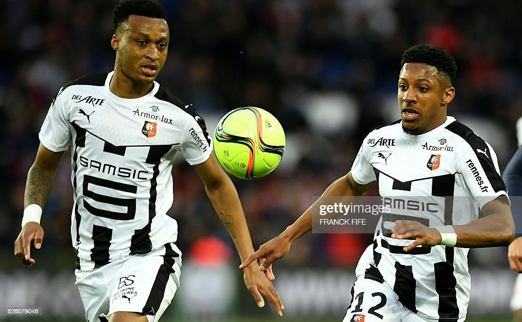 Rennes' French defender Steven Moreira (R) eyes the ball during the French L1 football match between Paris Saint-Germain and Rennes at the Parc des Princes stadium in Paris on April 30, 2016. / AFP / FRANCK