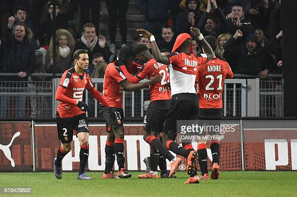 Rennes' French forward Jeremie Boga celebrates with teammates after scoring during the French L1 football match between Rennes and Lyon at Roazhon...