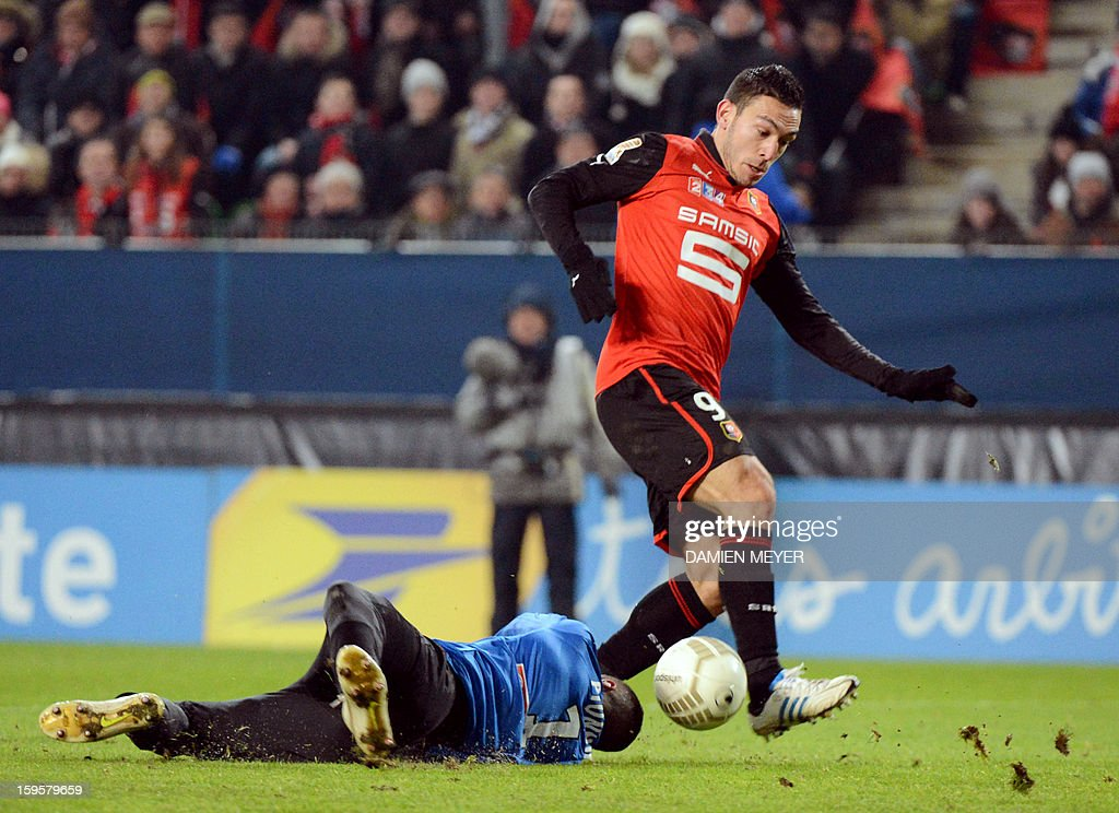 Rennes' French forward Mevlut Erding (R) avoids Montpellier's French goalkeeper Laurent Pionnier to score a goal during the French League Cup semifinal football match Rennes against Montpellier on January 16, 2013 at the route de Lorient stadium in Rennes, western France. AFP PHOTO / DAMIEN MEYER