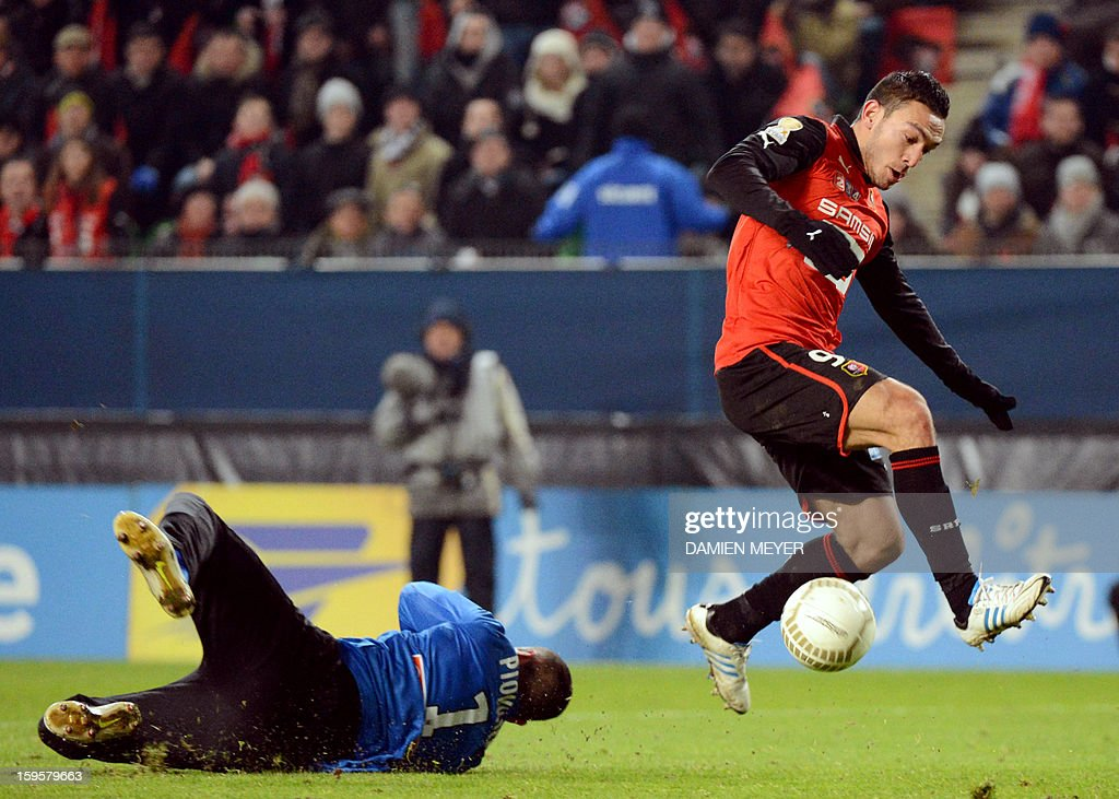 Rennes' French forward Mevlut Erding (R) avoids Montpellier's French goalkeeper Laurent Pionnier to score a goal during the French League Cup semifinal football match Rennes against Montpellier on January 16, 2013 at the route de Lorient stadium in Rennes, western France.