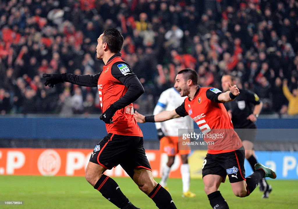 Rennes' French forward Mevlut Erding (L) celebrates after scoring a goal during a French League Cup semifinal football match between Rennes and Montpellier on January 16, 2013 at the route de Lorient stadium in Rennes, western France.