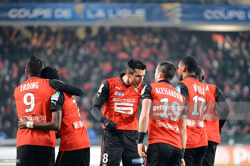 Rennes' French forward Mevlut Erding (L) celebrates after scoring a goal with French midfielder and captain Julien Feret (C) during a French League Cup semifinal football match between Rennes and Montpellier on January 16, 2013 at the route de Lorient stadium in Rennes, western France.