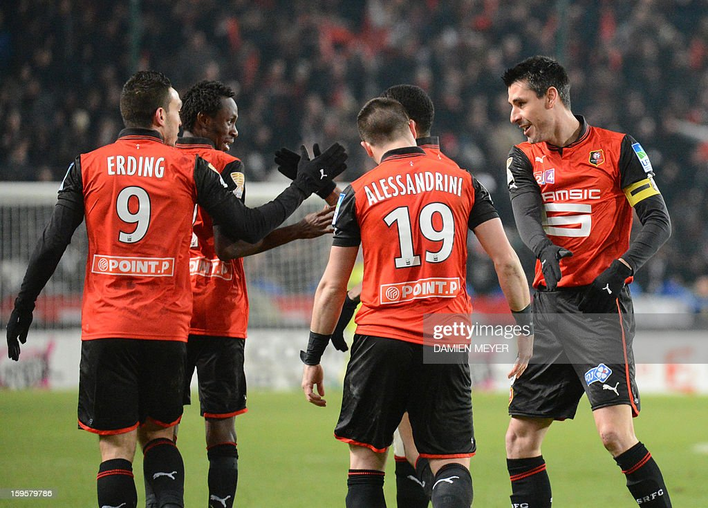 Rennes' French forward Mevlut Erding (L) celebrates after scoring a goal with French midfielder and captain Julien Feret (R) during a French League Cup semifinal football match between Rennes and Montpellier on January 16, 2013 at the route de Lorient stadium in Rennes, western France.