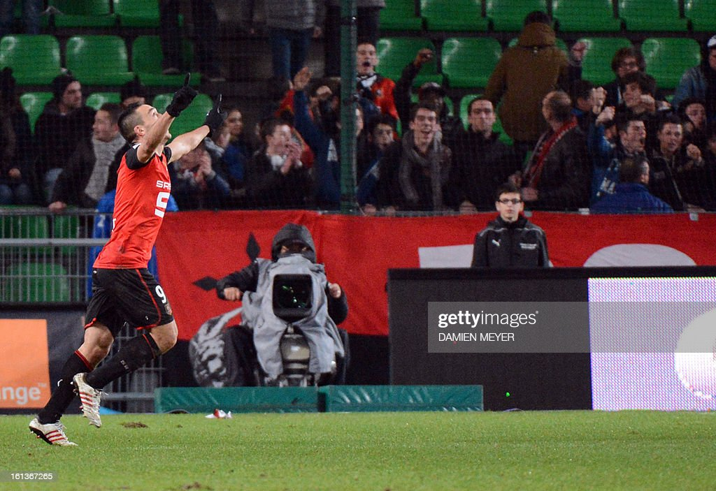 Rennes' French forward Mevlut Erding (L) celebrates after scoring during the French L1 football match Rennes (SRFC) against Toulouse (TFC) on February 10, 2013 at the Route de Lorient stadium in Rennes, western France.