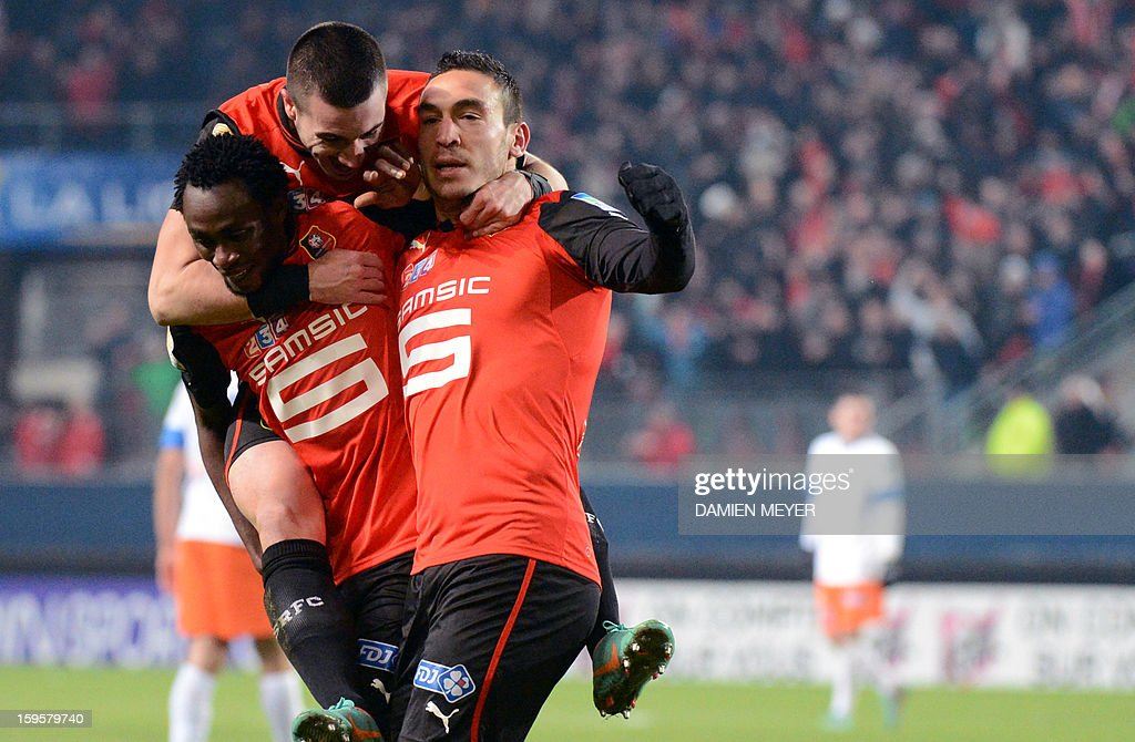 Rennes' French forward Mevlut Erding (R) celebrates after scoring with team mates, French forwards Jonathan Pitroipa (L) and Romain Alessandrini (C), during a French League Cup semifinal football match between Rennes and Montpellier on January 16, 2013 at the route de Lorient stadium in Rennes, western France.