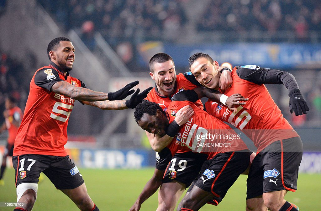 Rennes' French forward Mevlut Erding (R) celebrates after scoring with team mates, French forwards Jonathan Pitroipa (2nd L) and Romain Alessandrini (C), and French midfielder Yann M'vila (L) during a French League Cup semifinal football match between Rennes and Montpellier on January 16, 2013 at the route de Lorient stadium in Rennes, western France. AFP PHOTO / DAMIEN MEYER