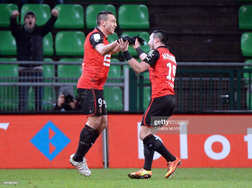 Rennes' French forward Mevlut Erding (L) celebrates with Rennes' French forward Romain Alessandrini after scoring during the French L1 football match Rennes (SRFC) against Toulouse (TFC) on February 10, 2013 at the Route de Lorient stadium in Rennes, western France.
