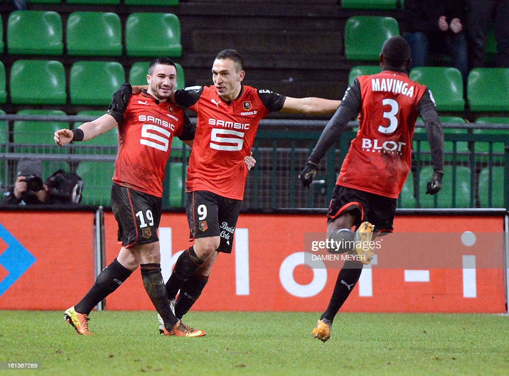 Rennes' French forward Mevlut Erding (C) celebrates with teammates French forward Romain Alessandrini (L) and French defender Chris Mavinga (R) after scoring during the French L1 football match Rennes (SRFC) against Toulouse (TFC) on February 10, 2013 at the Route de Lorient stadium in Rennes, western France.