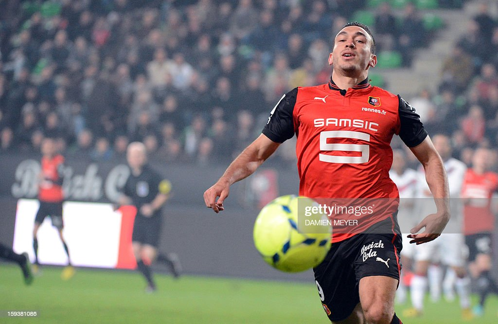 Rennes' French forward Mevlut Erding eyes the ball during a French L1 football match between Rennes and Bordeaux on January 12, 2013 at the route de Lorient stadium in Rennes, western France.