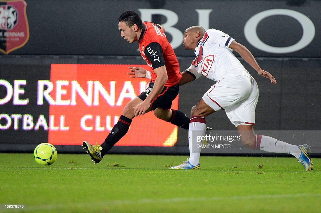 Rennes' French forward Mevlut Erding (L) fights for the ball with Bordeaux's Brazilian defender Carlos Henrique during a French L1 football match between Rennes and Bordeaux on January 12, 2013 at the route de Lorient stadium in Rennes, western France.
