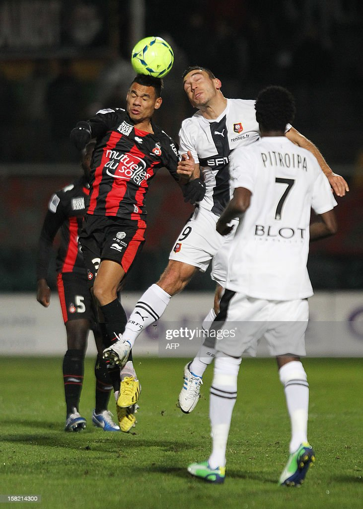Rennes' French forward Mevlut Erding (R) fights for the ball with Nice's French defender Thimothee Kolodziejczak (L) during the French L1 football match Nice (OGCN) vs Rennes (SRFC), on December 11, 2012 at the Ray stadium, in Nice, southestern France.