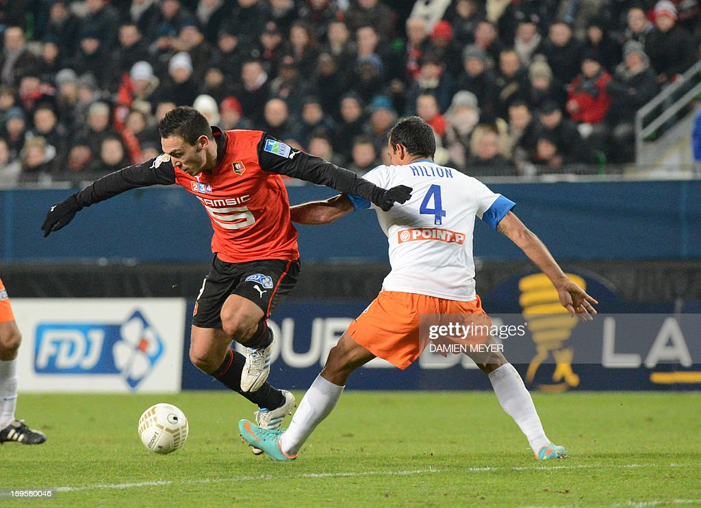 Rennes' French forward Mevlut Erding (L) fights for the ball with Montpellier's Brazilian defender Vitorino Hilton during the French League Cup semifinal football match Rennes against Montpellier on January 16, 2013 at the route de Lorient stadium in Rennes, western France.